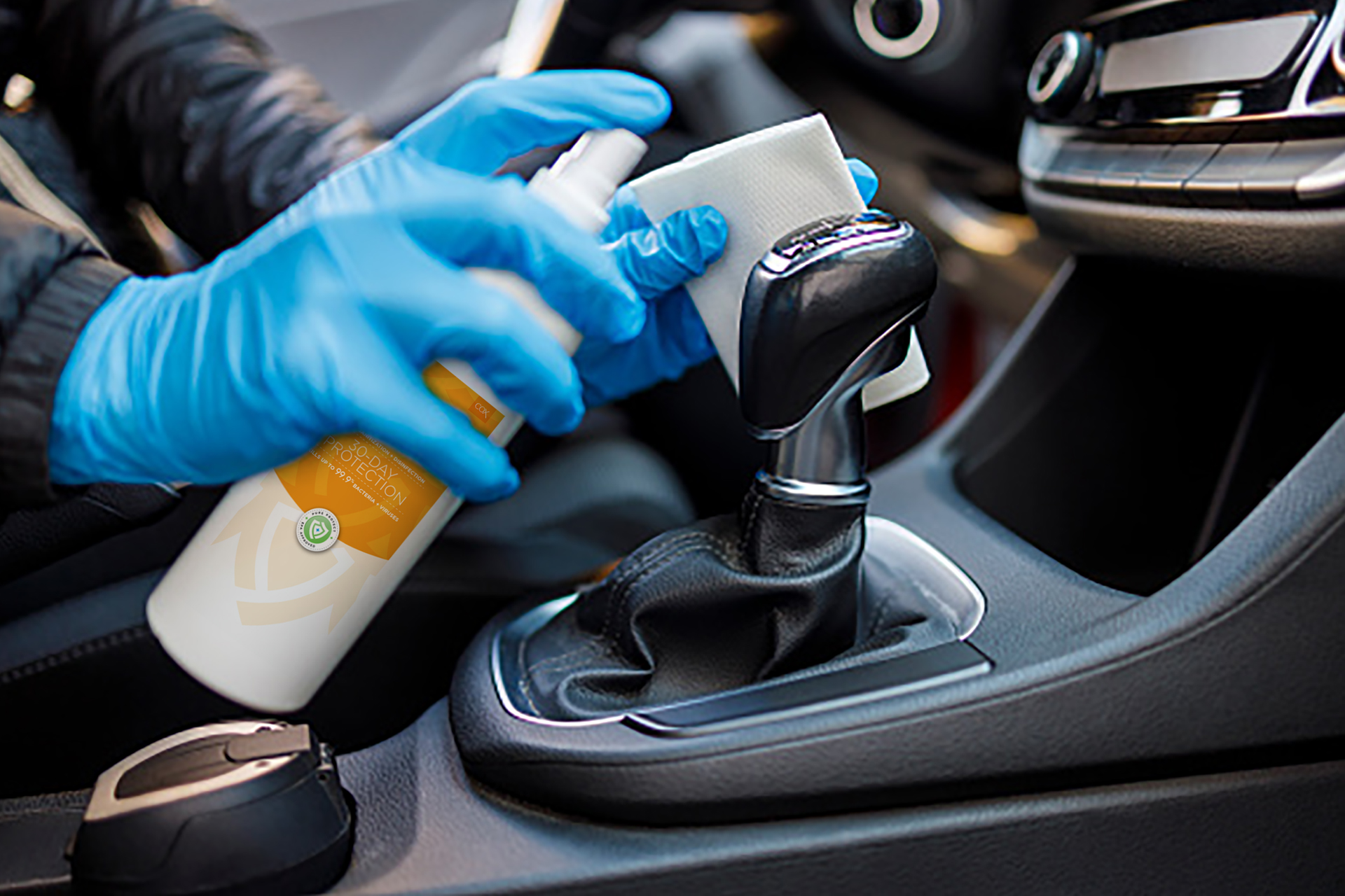 A concierge disinfects a vehicle interior