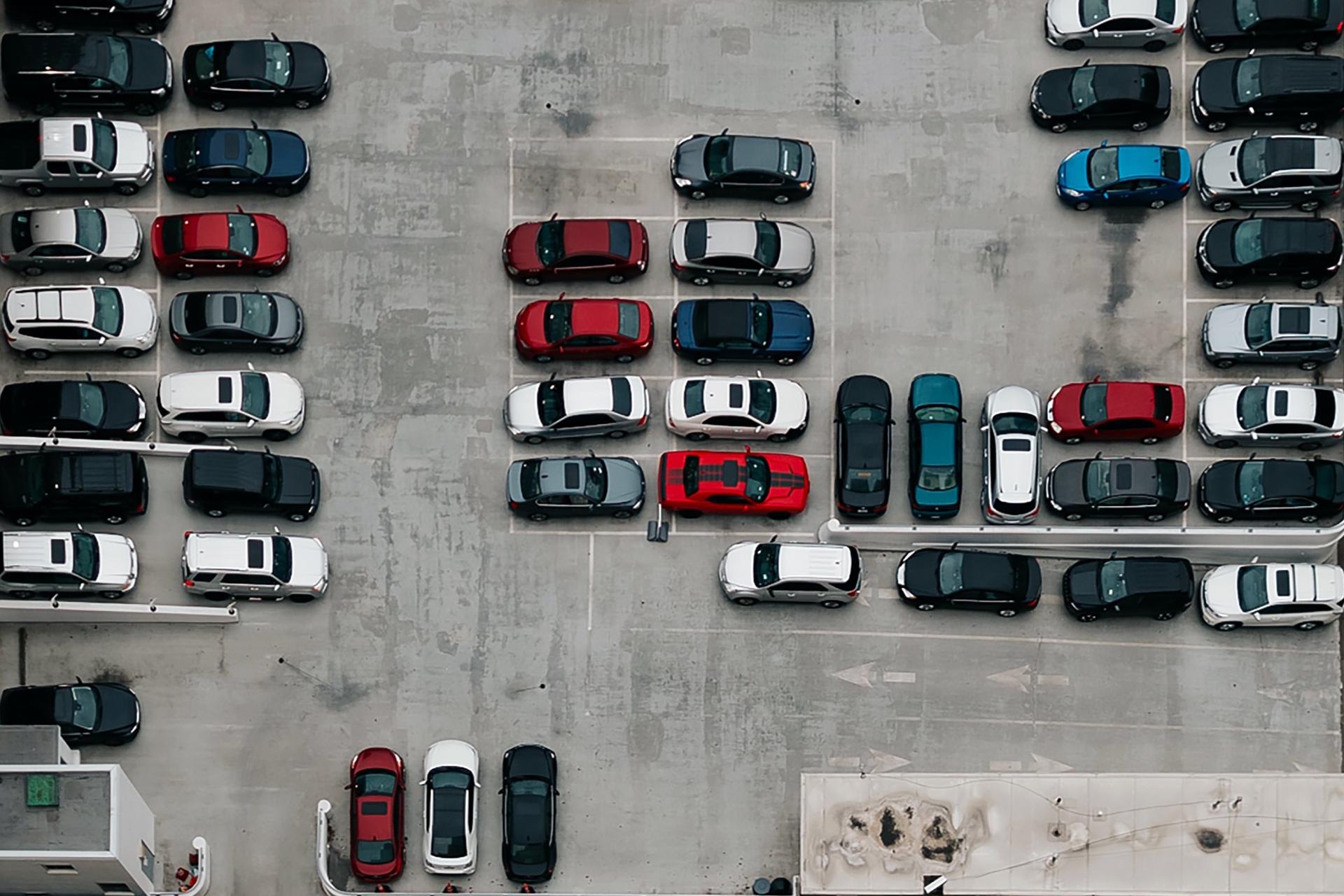 Crowded car lot. Photo by Ivana Cajina on Unsplash.