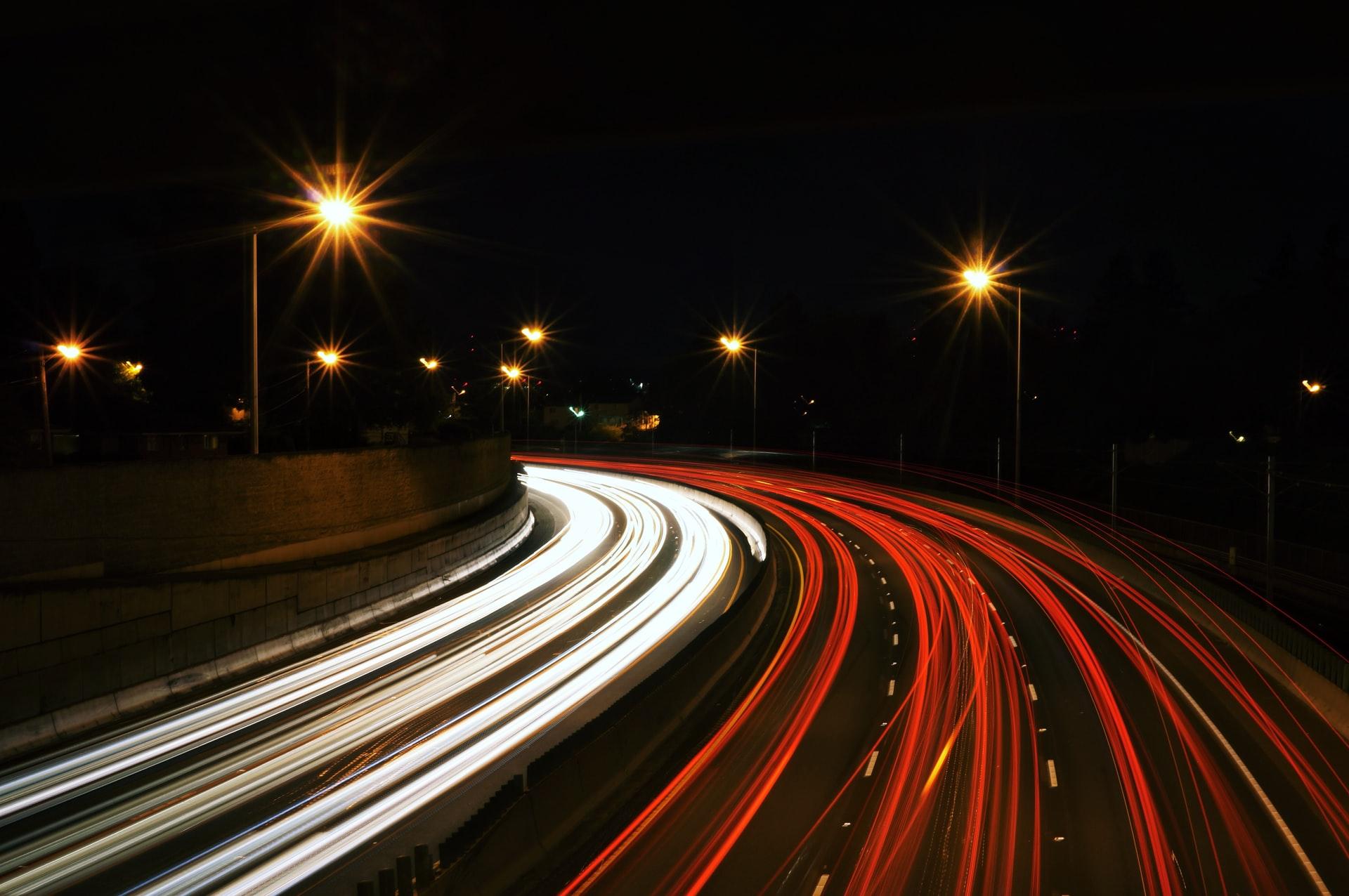 Nightime traffic. Photo by Jake Givens on Unsplash.